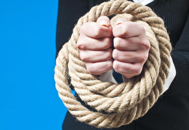 Hands Tied With Rope Stock Photo