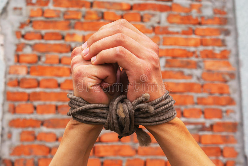Hands tied up with rope stock photos