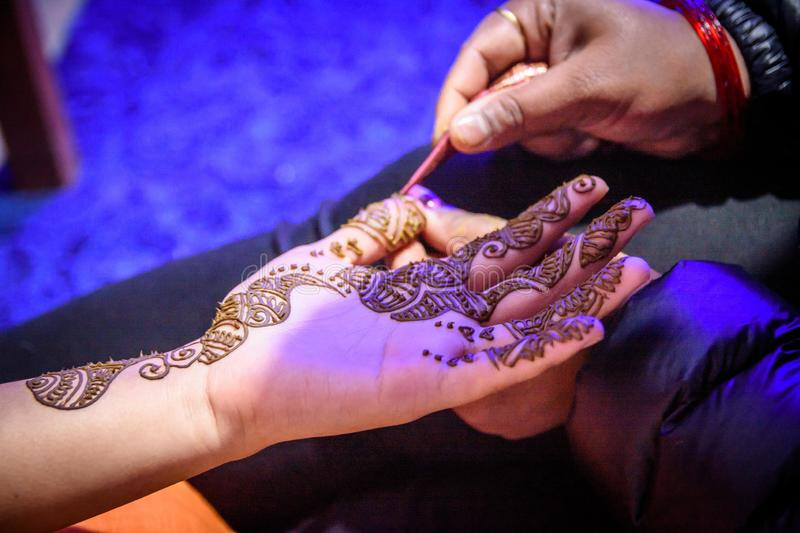 Mehendi Rasm. Hands at the time of Mehendi Rasm during Hindu marriage stock images