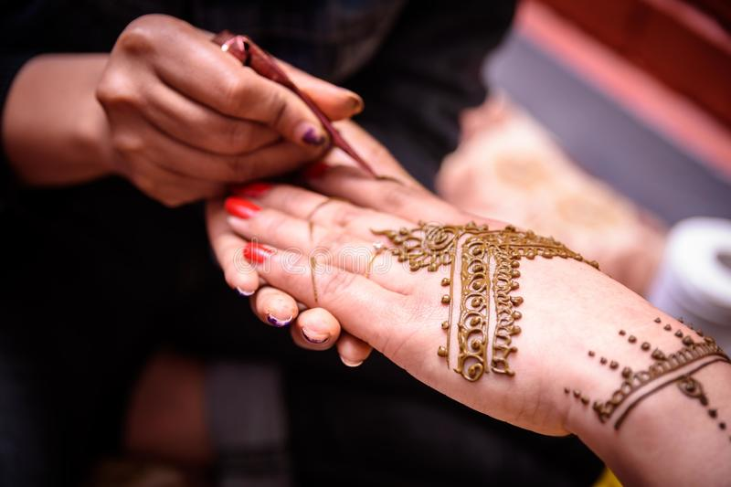 Mehendi Rasm. Hands at the time of Mehendi Rasm during Hindu marriage stock photos