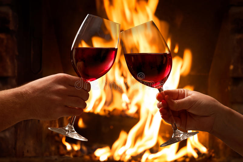 Hands toasting wine glasses royalty free stock images