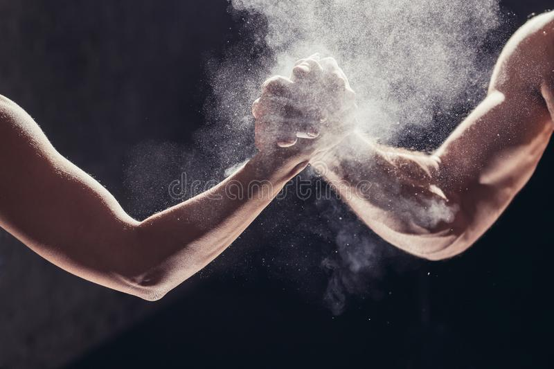 Hands together - fitness team after training - high five. togetherness concept royalty free stock image
