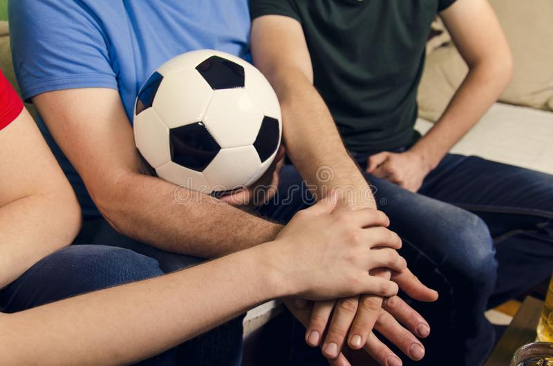 Hands together and soccer ball in the middle stock photos