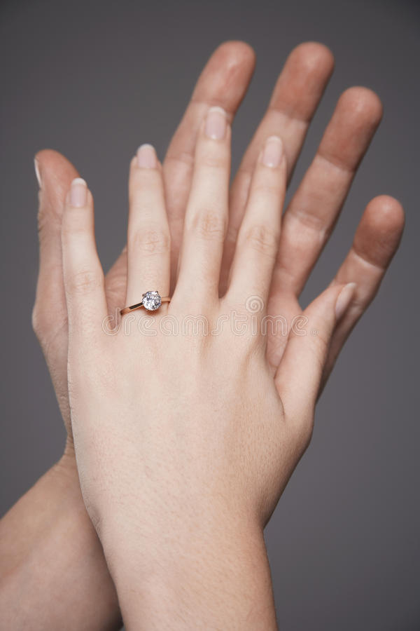 Hands Together With Woman S Engagement Ring Stock Images