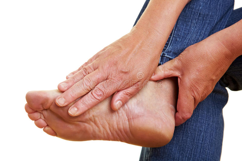 Hands touching naked foot royalty free stock photo