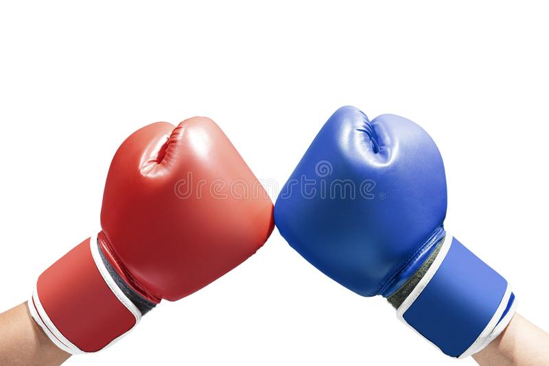 Hands of two men with blue and red boxing gloves. Isolated over white background royalty free stock photos