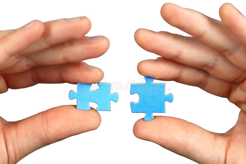 Hands with two puzzles royalty free stock photography