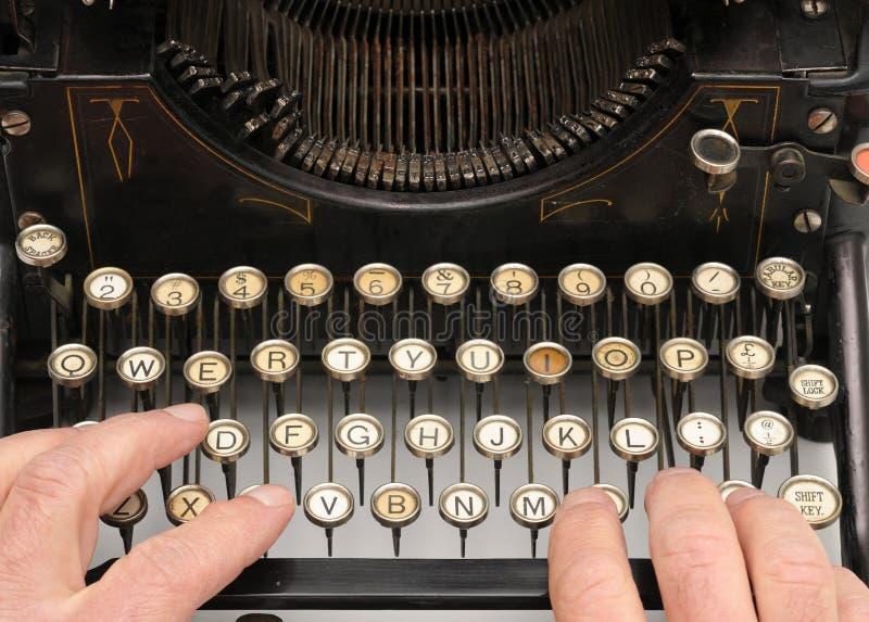 Hands on typewriter keybord. Typing on an old typewriter royalty free stock images