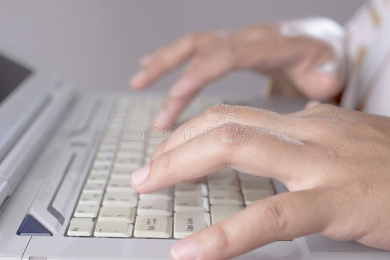 Hands Typing on laptop stock photos