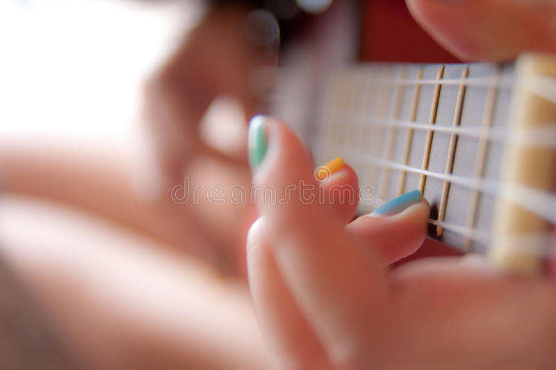 Hands with a ukulele stock photography