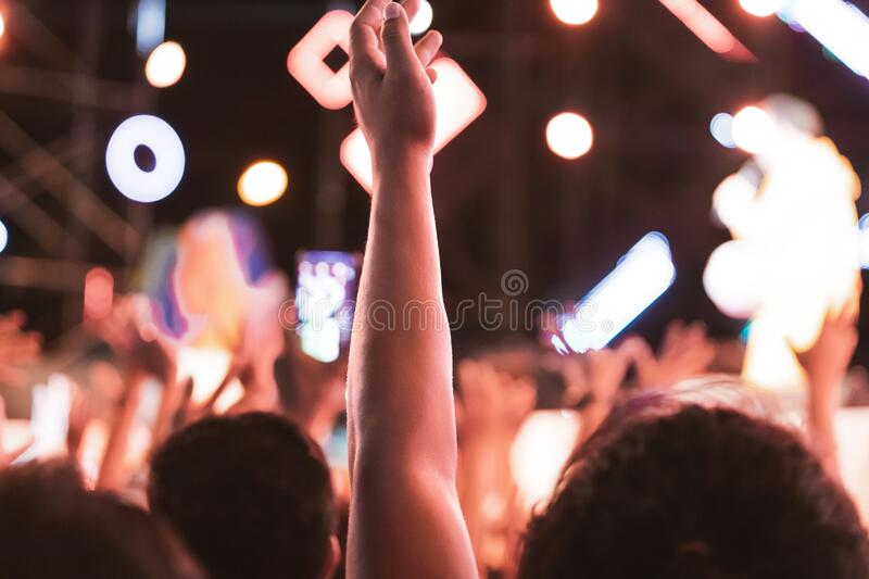 Hands of Unidentified crowed people having fun in music concert festival.  stock images