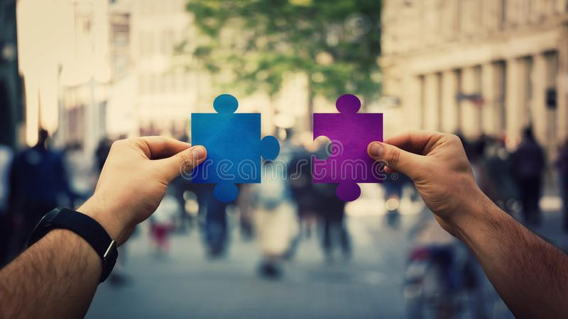 Hands unite puzzle jigsaw pieces royalty free stock image
