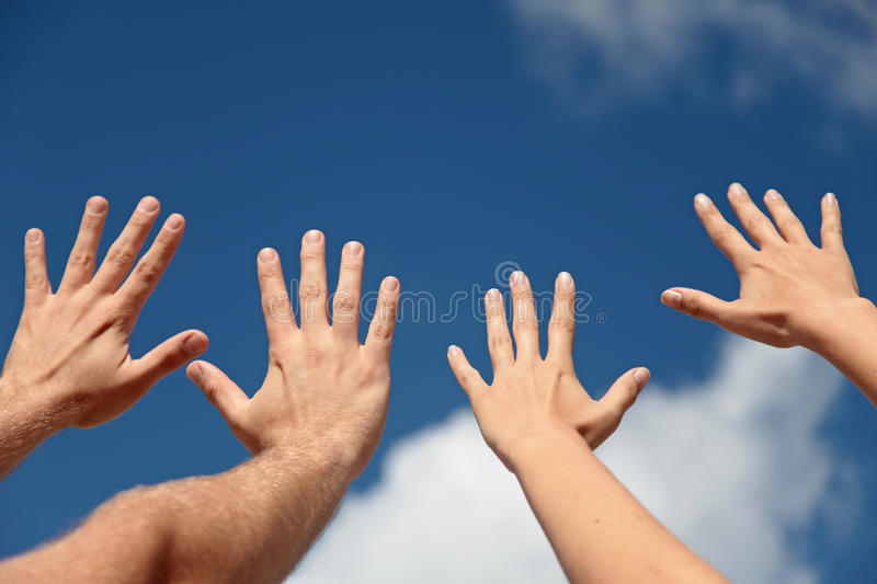 Hands up in the air stock photos