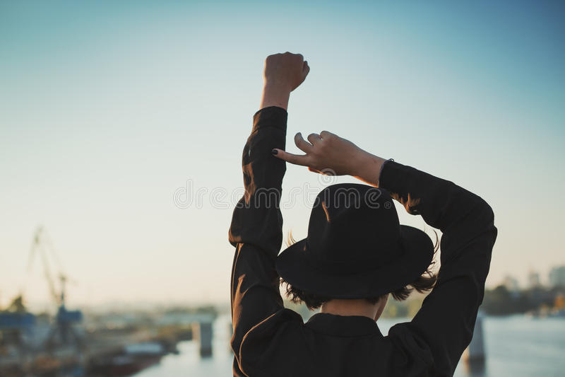 Hands up in the air. Port at the background city romantics royalty free stock photography