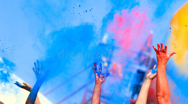 Hands up on color Holi Festival royalty free stock photos