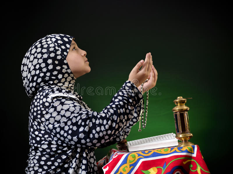 Hands Up Young Muslim Girl Praying royalty free stock photography
