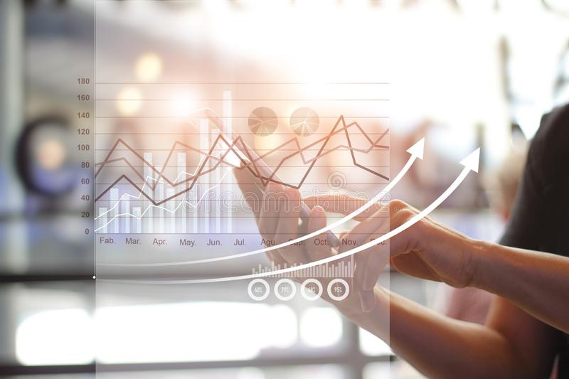 Hands using mobile and analyzing sales data and economic growth graph chart, payments, Digital marketing. Banking network. stock photography
