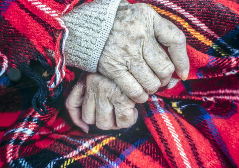 Hands of very old woman royalty free stock image