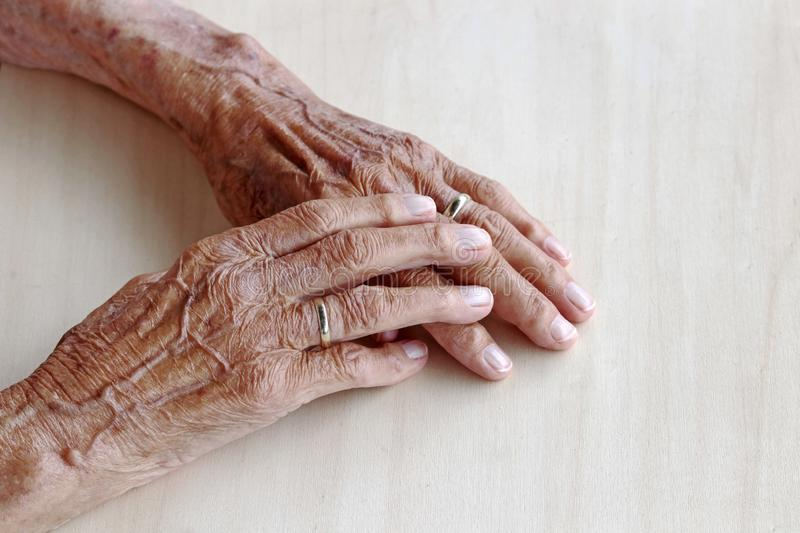 The hands of a very old woman stock photo