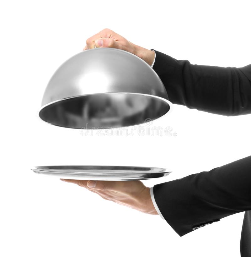 Hands of waiter holding metal tray with cover stock images