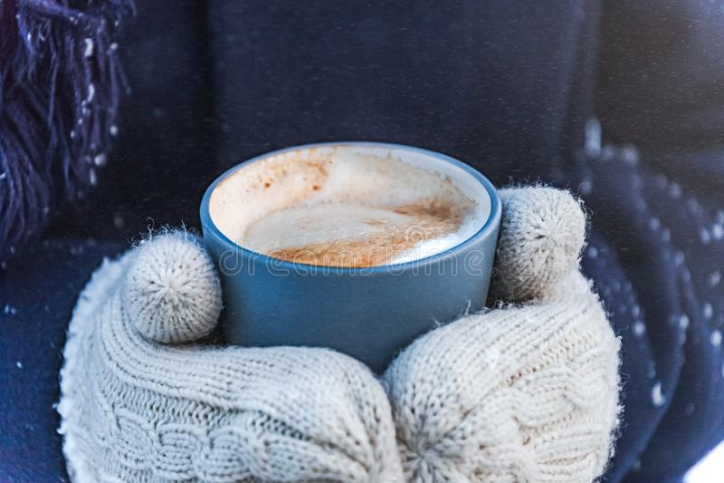 Winter coffee in snow street royalty free stock images