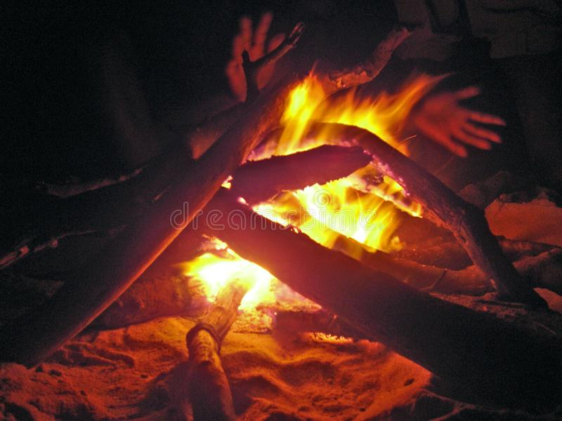 Hands warming at beach fire. Hands warming at fire on kosi Bay beach after a long fishing day royalty free stock photos