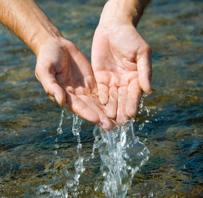 Hands in water stock photos
