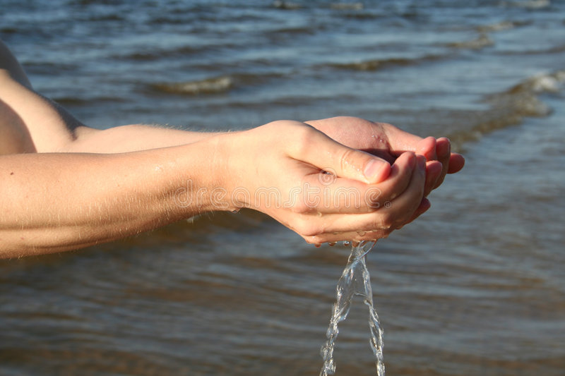 Hands_water images libres de droits
