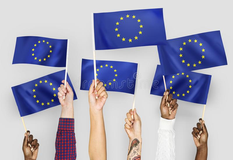 Hands waving flags of the EuropeanUnion stock images
