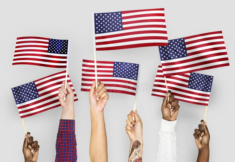 Hands waving flags of the United States royalty free stock photo