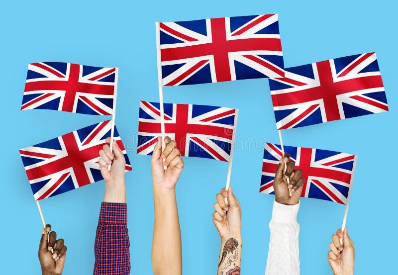 Hands waving national flag of the United Kingdom royalty free illustration