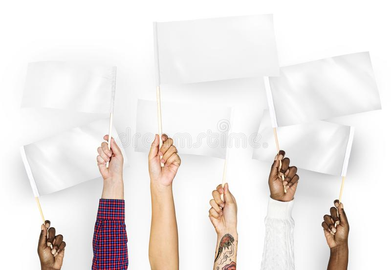 Hands waving white empty flags stock image