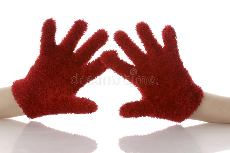 Hands wearing mittens royalty free stock photos