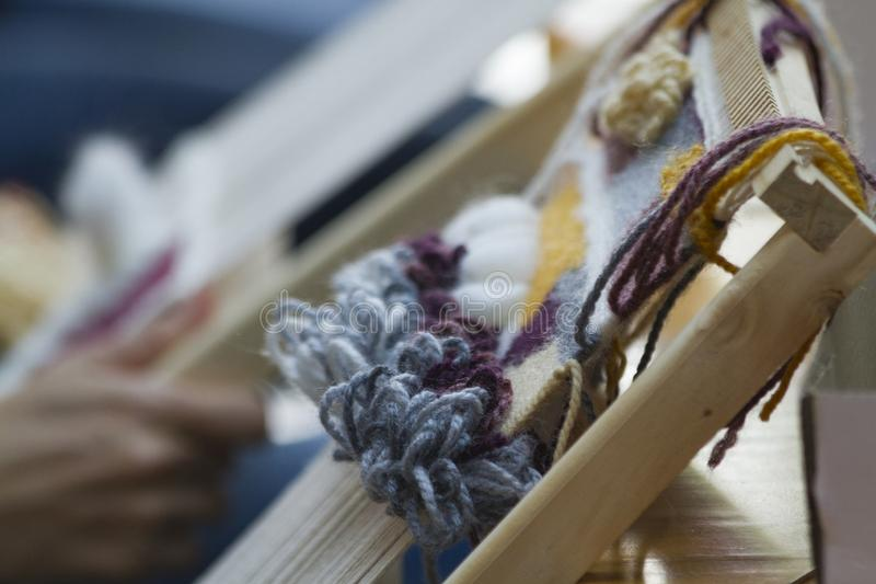 Vertical tapestry with beige yellow and blue  thread royalty free stock photos