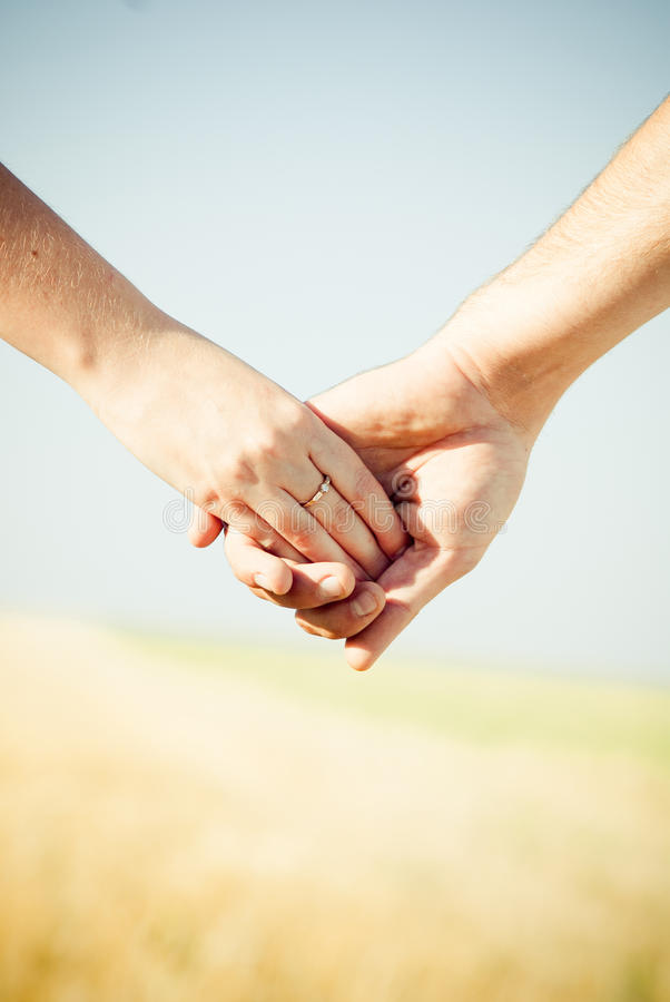 Hands with Wedding Ring. Close-up Holding Hands with Wedding Ring stock images