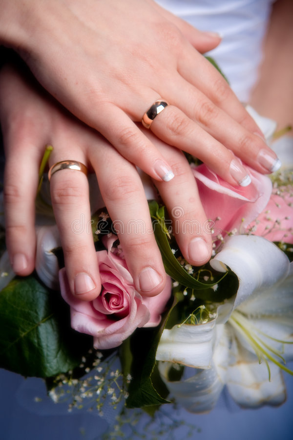 Download Hands With Wedding Rings Royalty Free Stock Image - Image: 4531016