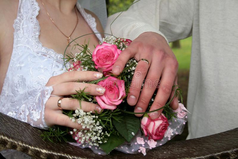 Hands with wedding rings. Hands of the groom and the bride with wedding rings stock images