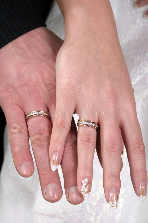 Hands with wedding rings. Hands of the groom and the bride with wedding rings royalty free stock photo