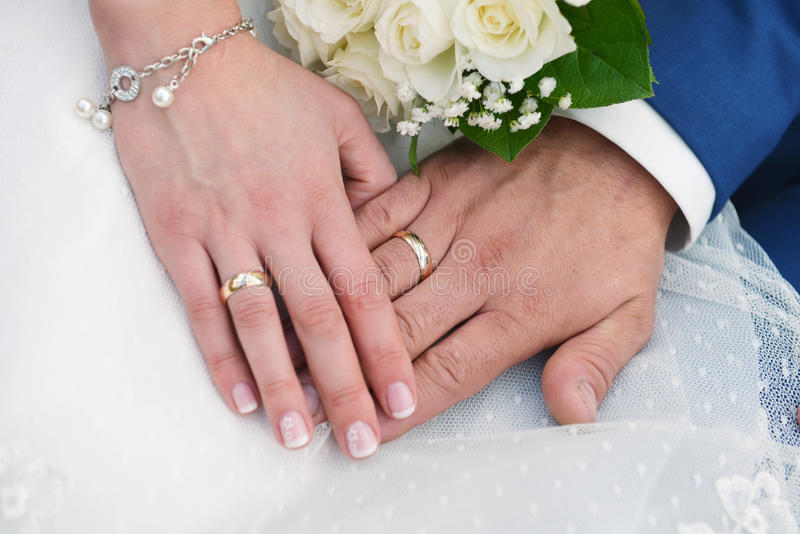 hands with wedding rings stock photo image 49719536