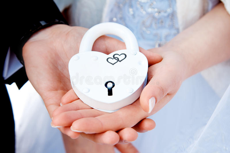 Hands and white lock. stock image