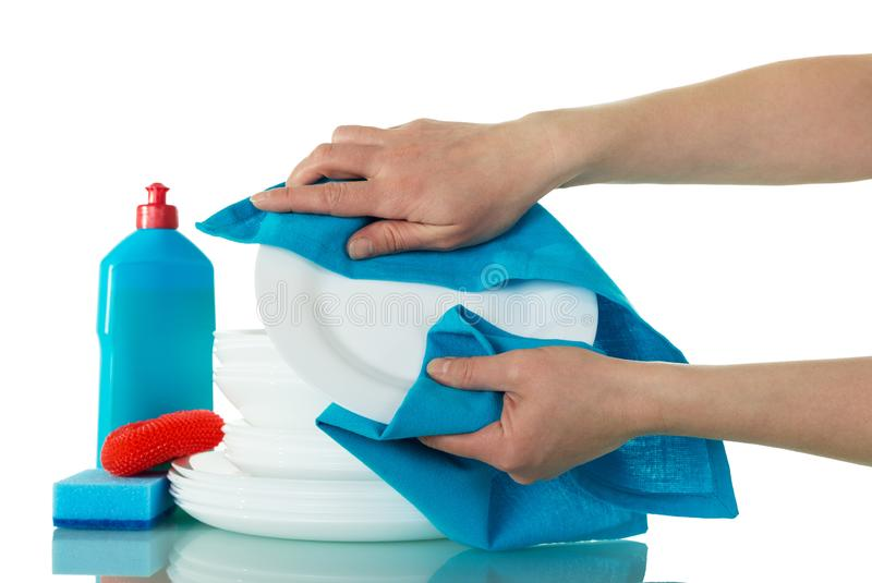 Hands are wiping blue towel on clean plate isolated on a white background royalty free stock photos