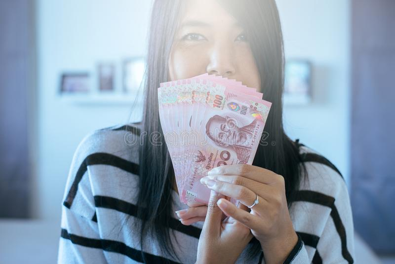 Hands woman counting Thai money. 100 banknotes royalty free stock photography