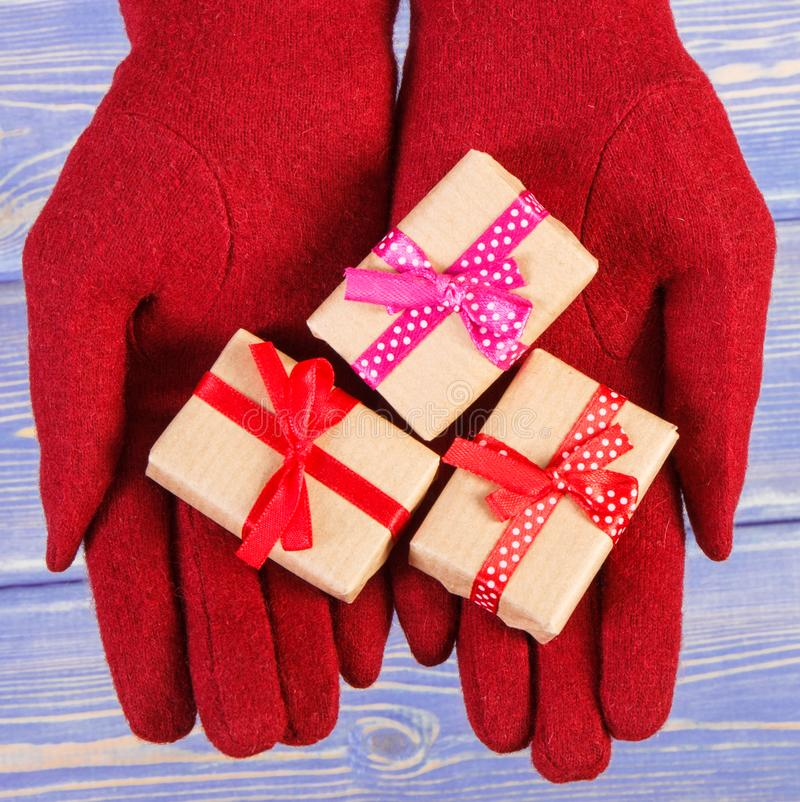 Hands of woman with gifts for Christmas or other celebration stock image