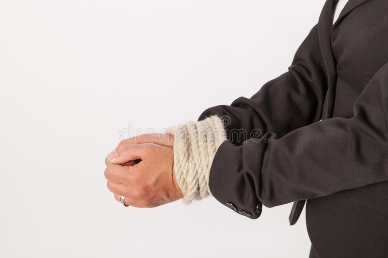 The hands of a woman are handcuffed stock photo