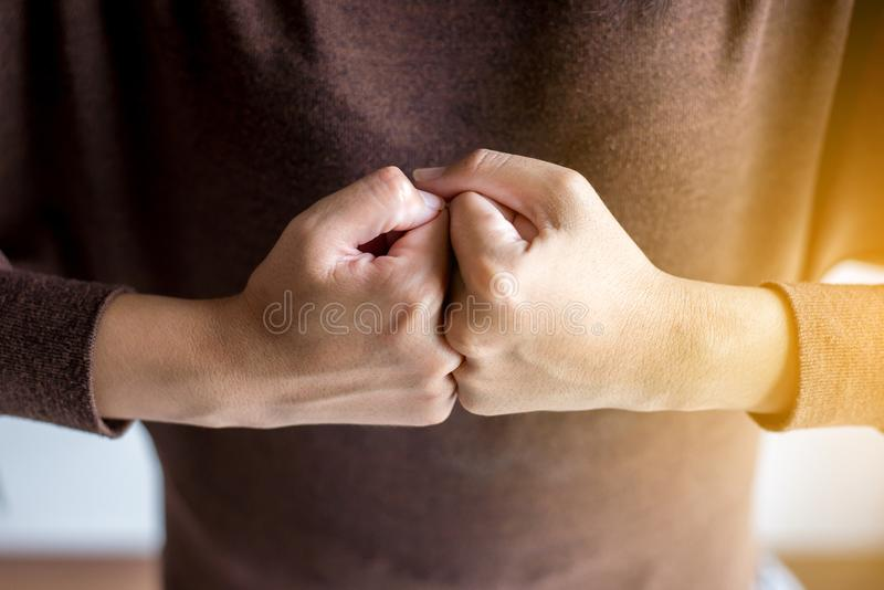 Hands of woman show strength teamwork,Fist bump and putting her hand. Hands of women show strength teamwork,Fist bump and putting her hand royalty free stock photography