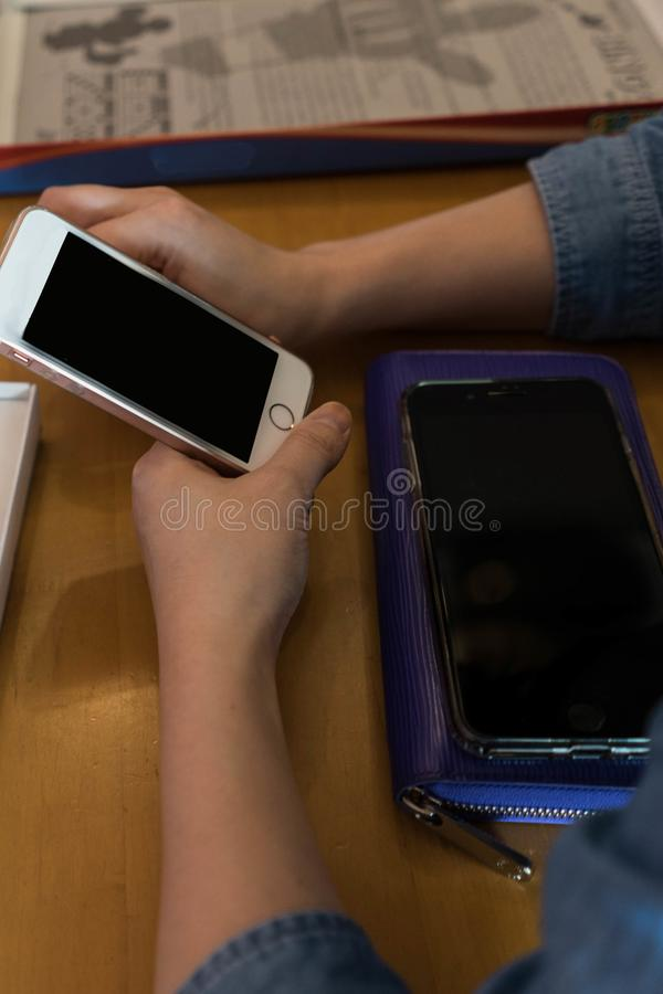 Hands of woman use smart phone for business and finance while an stock photography