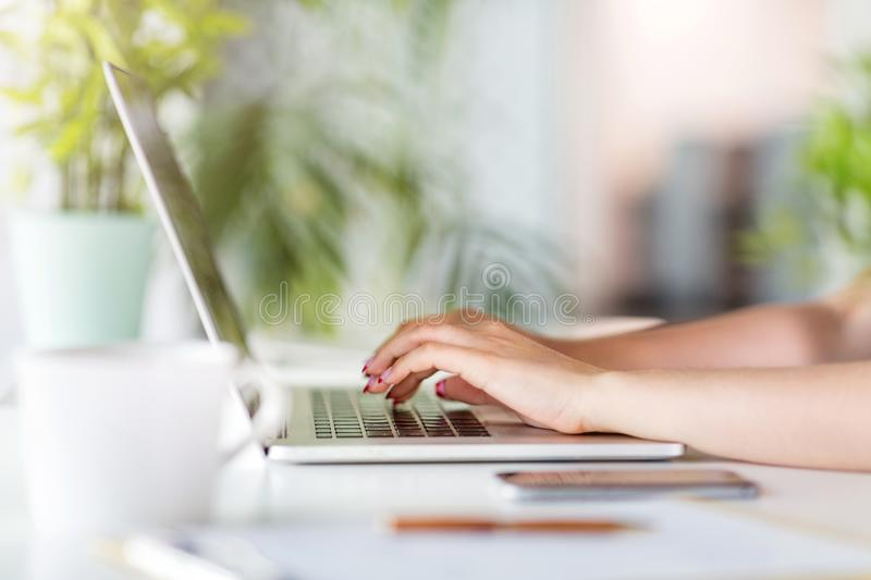 Hands of a woman working on a laptop royalty free stock photos