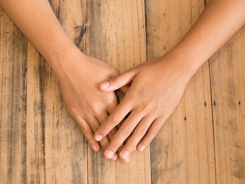 hands on wood table royalty free stock photo
