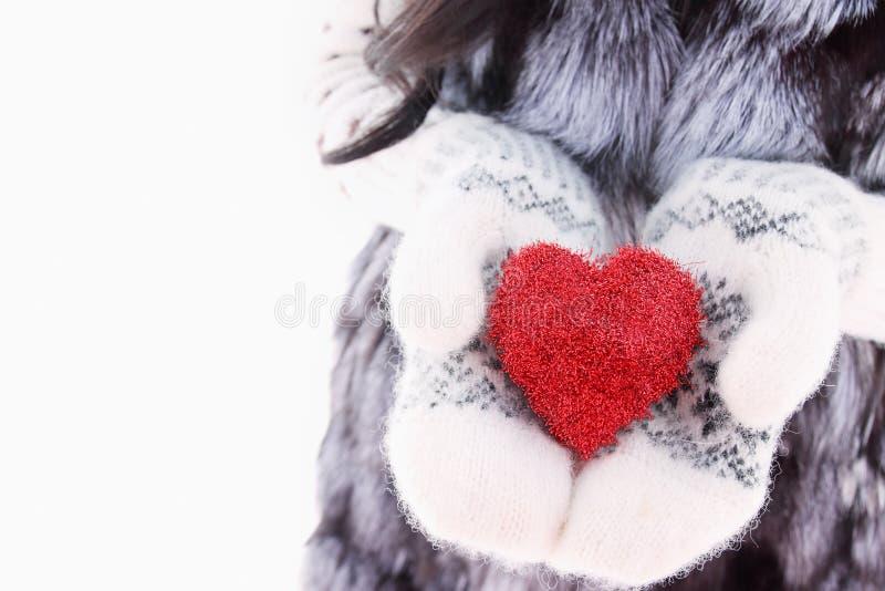 Hands in woolen mittens stock image