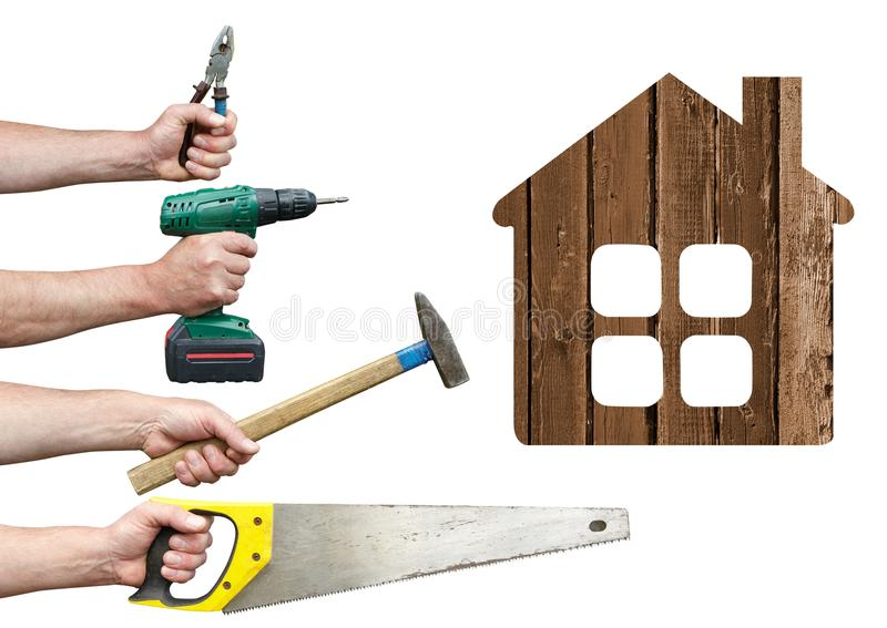 Hands of workers with tool and house stock photography